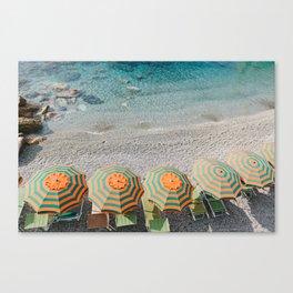 Umbrellas on the beach Canvas Print