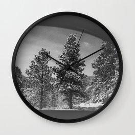 Snowy Pines Through the Explorers Window Wall Clock