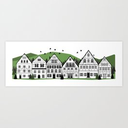 german bavarian town with typical houses and forest background Art Print