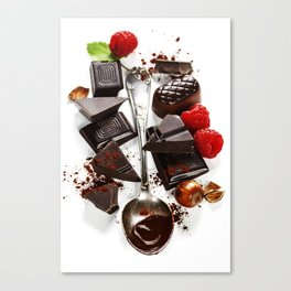 An assortment of  chocolate on white background Canvas Print