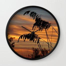 Silhouetted wheat grass sunrise Wall Clock