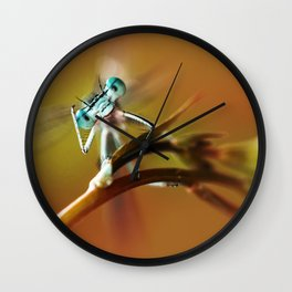 Blue dragonfly on pink flower Wall Clock