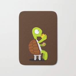Turtle drinking tea with cookies. Bath Mat