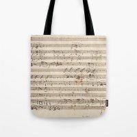 mozart Tote Bags featuring Mozart by Le petit Archiviste
