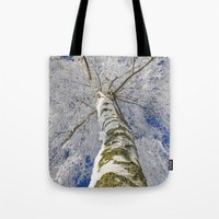 john snow Tote Bags featuring Snow worlds by Tanja Riedel