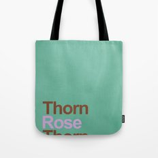 A rose between two thorns Tote Bag