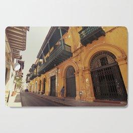 Swinging Yellow - Enchanting Cartagena de Indias - Magical Realism Cutting Board