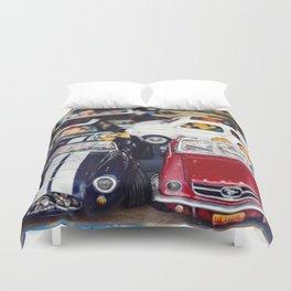 miniature retro convertible car in a shop Duvet Cover