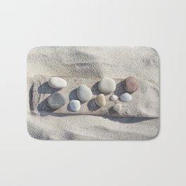 Beach pebble driftwood still life Bath Mat