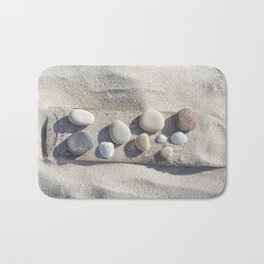 Beach pebble driftwood still life Bath Mat
