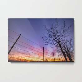 Fiery sunset viewed through barbed fence Metal Print