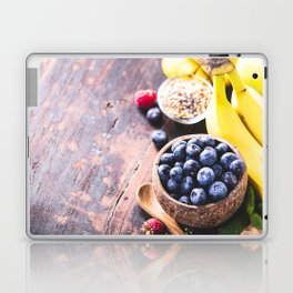 Close-up of fresh fruits and seeds in wooden tray Laptop & iPad Skin