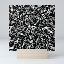 Monochrome strict abstraction of rounded black and white triangles and smooth lines. Mini Art Print