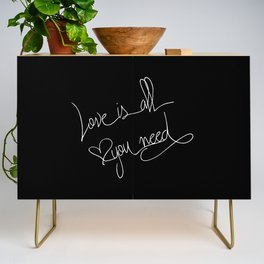 Love is all you need white hand lettering on black Credenza