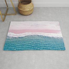 Pink sand turquoise sea Rug