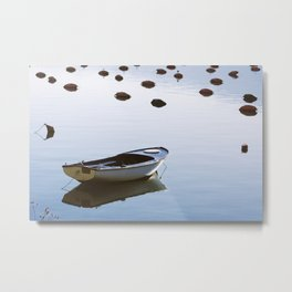 Water mirror and a small boat Metal Print