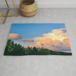 Sunset Clouds through Window Rug