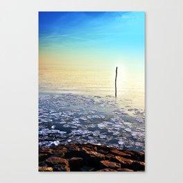 Sun going down in calm frozen lake Canvas Print