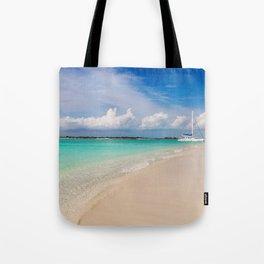 Catamaran on deserted white sand beach Tote Bag