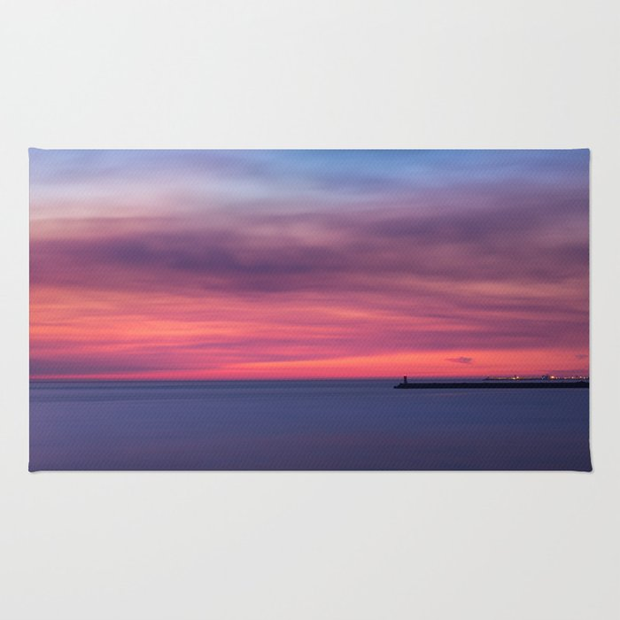 Red sunset over the ocean Rug