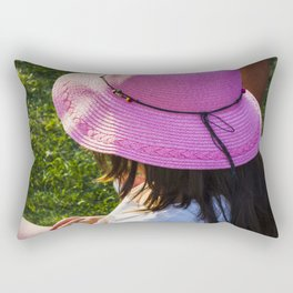 Big pink hat for a child girl on the grass Rectangular Pillow