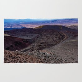 Lava field. Lava mountains of different colors. Rug