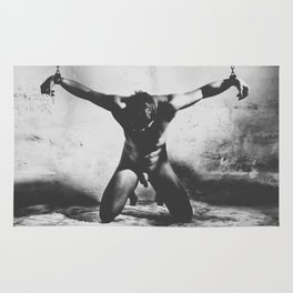 Naked man shackled in a dungeon with heavy iron cuffs Rug
