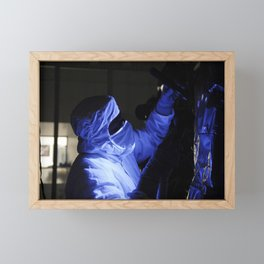 At the Astrotech facility in Titusville Fla technicians perform backlight inspection and cleaning on Framed Mini Art Print