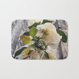 Beautiful White Clematis Flowers Hanging Over a Fence Bath Mat