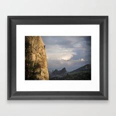 Climbing at sunset Framed Art Print