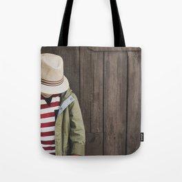 Little boy on wooden background Tote Bag