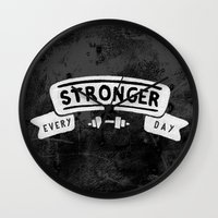 crossfit Wall Clocks featuring Stronger Every Day (dumbbell, black & white) by Lionheart Art