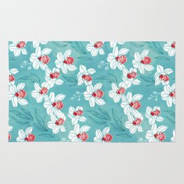 Orchid garden in peach on turquoise green Rug