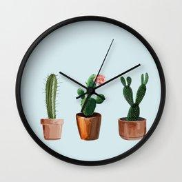 Three Cacti On Light Blue Background Wall Clock