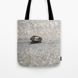 Sun Reflected in a Shell on a Sparkling Sandy Beach Tote Bag