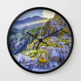 Beautiful curvy rock formations carved by the retreat of Franz Josef Glacier, South Island, New Zealand Wall Clock
