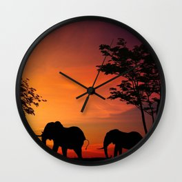 Elephants in the African sunset Wall Clock