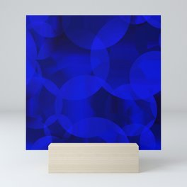 Abstract soap of ultramarine molecules and transparent bubbles on a deep blue background. Mini Art Print