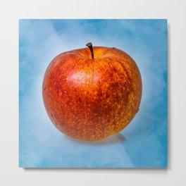 Red apple fruit against light blue background Metal Print