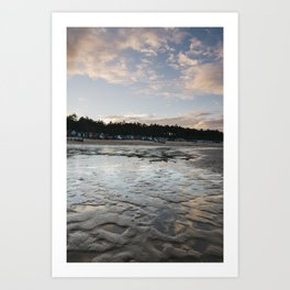 Sunset sky and beach huts reflected in a water at low tide. Wells-next-the-sea, Norfolk, UK. Art Print