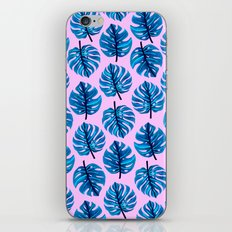 Blue monstera leaves pattern on pink background iPhone & iPod Skin