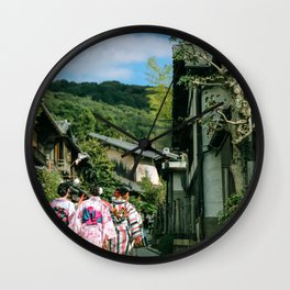 Three Women in Traditional Robes Walking through a Japanese Village Wall Clock