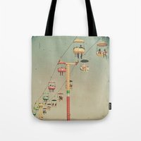 1975 Tote Bags featuring 1975 Ride by Maite Pons