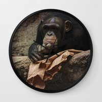 newspaper Wall Clocks featuring bored chimpanzee after reading newspaper by UtArt
