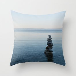 Balance stone pyramid on the sea coast in Croatia Throw Pillow