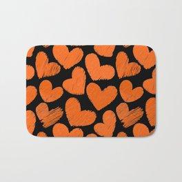 Sketchy hearts in orange and black Bath Mat