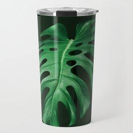 Vivid green monstera leaf on dark background Travel Mug