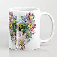 skulls Mugs featuring SKULLS by RIZA PEKER
