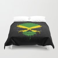 jamaica Duvet Covers featuring Flag of Jamaica on a Chaotic Splatter Skull by Jeff Bartels