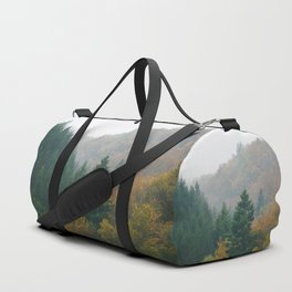 Foggy autumn forest layers disappearing in fog Duffle Bag